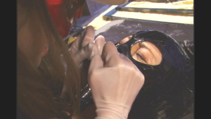 ...rips catwoman's mask!